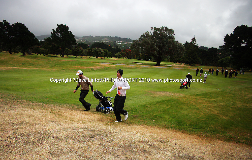 Nick Gillespie walks up the 17th fairway.<br /> North Island Men's Amateur Golf Championships at Hutt Golf Club, Wellington. Friday, 15 January 2010. Photo: Dave Lintott/PHOTOSPORT