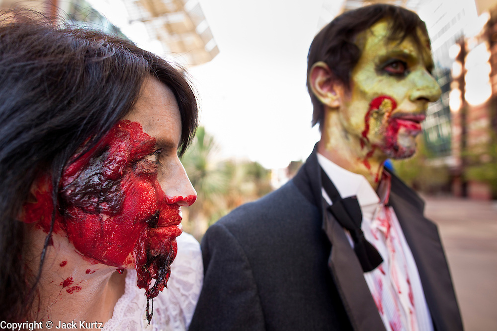 27 MAY 2011 - PHOENIX, AZ: CATHERINE SACS and her husband, ROB SACS, from Tucson, AZ, celebrate their 25th anniversary as zombies in the Zombie Walk at Phoenix Comicon Friday. Phoenix Comicon opened Thursday and featured a Zombie Walk through downtown Phoenix Friday night. Hundreds of people participated in the Zombie Walk, both as Zombies and as Zombie hunters. This year's Comicon includes appearances by Leonard Nimoy (Star Trek), Adam Baldwin (Firefly and Chuck), Stan Lee (Marvel Comics), Nicholas Brendon (Buffy the Vampire Slayer) and others. Activities include costuming workshops, role playing games and a Geek Prom.     Photo by Jack Kurtz