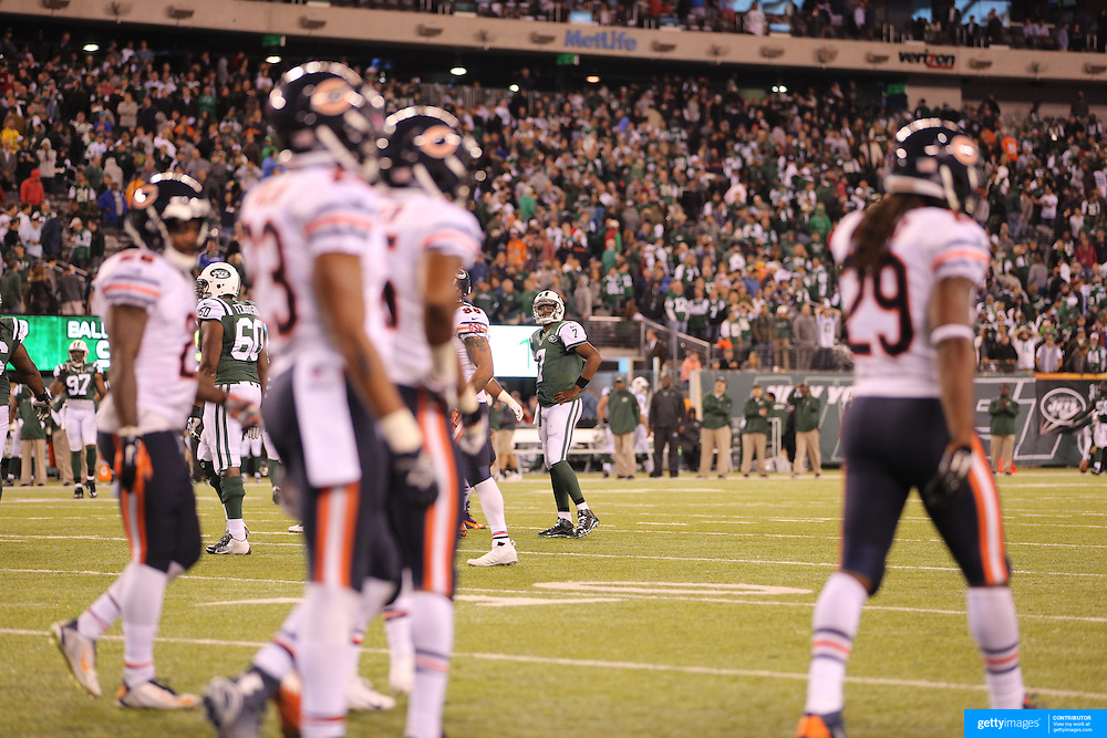 Geno Smith, New York Jets, dejected at the end of the game during the New York Jets Vs Chicago Bears, NFL regular season game at MetLife Stadium, East Rutherford, NJ, USA. 22nd September 2014. Photo Tim Clayton for the New York Times