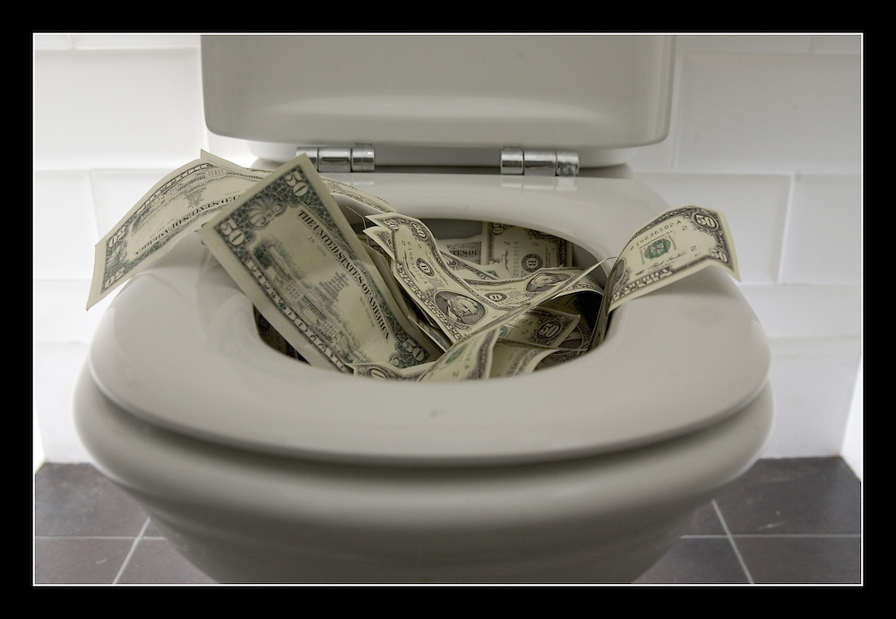 $ 50 Dollar being flushed down the toilet (prop money)