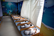 Young children having a daytime sleep in the child care centre at an Epyllion Group garment factory in Dhaka, Bangladesh.