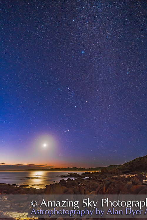 The western evening sky from the Gippsland Coast of Victoria, Australia on March 31, 2017. The latitude is 37&deg; South.<br /> <br /> The location is the West Cape of Cape Conran, looking west to the waxing crescent Moon above the Pleiades and below the Hyades in Taurus. At centre is Orion, upside down compared to the northern hemisphere view. The bright star at top centre is Sirius in Canis Major. Procyon is at right. Mars is just above the clouds at lower left. <br /> <br /> The Milky Way runs vertically from Taurus (below) to Canis Major (at top). Several star clusters are visible along the Milky Way, including M41, M46, &amp; M47.<br /> <br /> This is a stack of 8 15- and 30-second exposures, mean combined to smooth noise, for the ground, and one 15-second exposure for the sky. All at f/2.5 with the Rokinon 14mm lens wide open, and Canon 6D at ISO 3200. An additional 2-second exposure was blended in for the Earthlit Moon to prevent it from being overexposed too much. A Soft Glow effect from ADP Panel+ adds the softer effect to the ground.