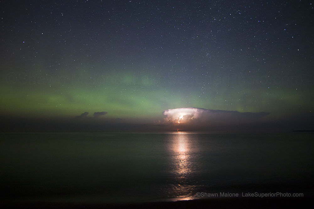 The aurora borealis northern lights showed up just enough to provide the backdrop for this passing isolated thunderstorm. Only had a couple chances to pick up a lightning bolt and this happened. From July, 2012- how rare is that? :)  Featured: Spaceweather.com 07/17/2012