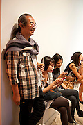 Haris Purnomo; ISHA HENING; AIRI WULAN, Indonesian Eye Contemporary Art Exhibition Reception, Saatchi Gallery. London. 9 September 2011. <br /> <br />  , -DO NOT ARCHIVE-© Copyright Photograph by Dafydd Jones. 248 Clapham Rd. London SW9 0PZ. Tel 0207 820 0771. www.dafjones.com.