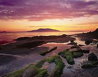 Sunset over Samish Bay from Larrabee State Park San Juan Islands in the distance, Washington USA