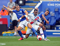 Football - 2019 / 2020 Premier League - Leicester City vs Crystal Palace<br /> <br /> Jordan Ayew of Palace is sandwiched between Caglar Soyuncu and Youri Tielemans, at the King Park Stadium<br /> <br /> COLORSPORT/ANDREW COWIE