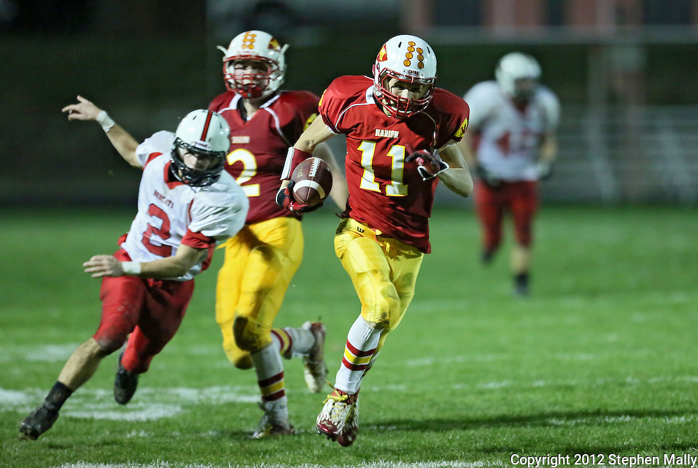 Marion's Quinn Cannoy (11) runs for the game winning touchdown as Western Dubuque's Dylan Gansen (2) give chase during their first round playoff game at Thomas Park Field in Marion on Wednesday, October 24, 2012.