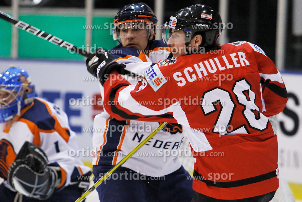 24.04.2010, Eishalle, IJssportcentrum, Tilburg, NED, IIHF Division I WM, Gruppe A, Österreich vs Niederlande im Bild David Schuller (r) clashes with Mark Tanner, EXPA Pictures © 2010, PhotoCredit/ EXPA/ Fintan Planting / SPORTIDA PHOTO AGENCY