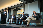Chris Burton moderates as panel members Bill Ng, Robert de Neve, and Richard Walkup, from left to right, discuss local manufacturing during the Silicon Valley Business Journal Power of Manufacturing Breakfast at the Silicon Valley Capital Club in San Jose, California, on January 24, 2017. (Stan Olszewski for Silicon Valley Business Journal)