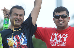 Johannesburg 19-12-18. South Africa Invitation XI vs Pakistan. Pakistan open their tour of South Africa with a three-day match at Sahara Willowmoore Park, Benoni. Day 1, afternoon session.  Pakistan cricket fans Salman Saleem from Lakeside and Atif Zia with chip sticks and cold drinks. Picture: Karen Sandison/African News Agency(ANA)