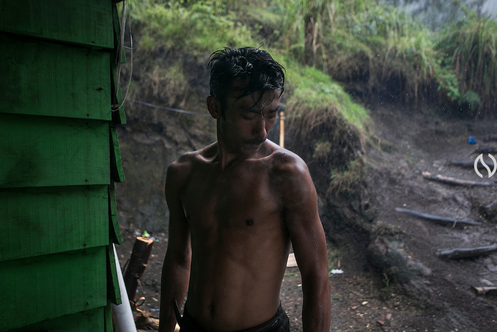 BONDOWOSO, EAST JAVA - DECEMBER 16: Miner takes a rest in a cabin.