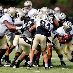 Aug 3, 2013; Metairie, LA, USA; New Orleans Saints running back Mark Ingram (22) runs with the ball during a scrimmage at the team training facility. Mandatory Credit: Derick E. Hingle-USA TODAY Sports