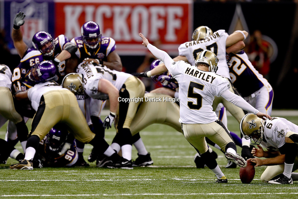 September 9, 2010; New Orleans, LA, USA;  New Orleans Saints place kicker Garrett Hartley (5) attempts a field goal during the NFL Kickoff season opener at the Louisiana Superdome. The New Orleans Saints defeated the Minnesota Vikings 14-9.  Mandatory Credit: Derick E. Hingle
