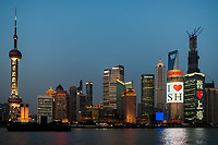 Shanghai, China - April 10, 2013: pudong waterfront at sunset at the city of Shanghai in China on april 10th, 2013