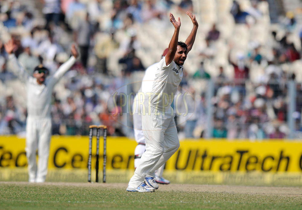 Mohammed Shami of India appeals successfully for the wicket of Marlon Samuels of West Indies during day three of the first Star Sports test match between India and The West Indies held at The Eden Gardens Stadium in Kolkata, India on the 8th November 2013<br /> <br /> Photo by: Pal Pillai - BCCI - SPORTZPICS
