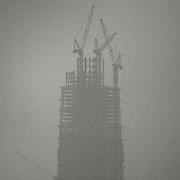 A high-rise building under construction is seen through the smog in Beijing.<br /> For years, China has resisted any outside pressure to curb their greenhouse gas emissions, citing their need and right to develop their economy. USA and China are the biggest carbon polluters in the world, and with both nations absent from international climate agreements, earlier climate negotiations have ended in toothless compromises.<br /> That could change with the COP21 Climate Conference in Paris. Already in December last year, both China and USA announced joint commitment to reduce emissions and increase renewable energy to 20 percent by 2030. China already has a substantial carbon trading system in place, second only to EU, and today (Sep 25th 2015) President Xi Jinping of China will announce how their cap-and-trade system can help to halt their growth of emissions by 2030. <br /> Speaking to Rolling Stone Magazine one year ago, Dan Dudeck (VP of the Environmental Defense  Fund) said &quot;If China is successful in using market forces to cap carbon and transform its economy, that may be the best shot we have to limit climate change.&quot;