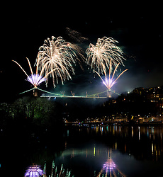 Fireworks a are launched from the Clifton Suspension Bridge as part of a free public display to celebrate the 150th anniversary of the opening of the Famous Bristol Landmark. The Grade I-listed bridge, which spans the Avon Gorge, first opened to the public on 8 December 1864 - Photo mandatory by-line: Joseph Meredith/JMP - 07966 386802 - 07/12/2014 - NEWS - Spike Island, Bristol - Clifton Suspension Bridge 150th Anniversary