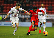 Josh Koroma holds the ball from Harry Taylor during the EFL Sky Bet League 2 match between Leyton Orient and Barnet at the Matchroom Stadium, London, England on 7 January 2017. Photo by Jack Beard.