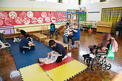Children with physical disabilities and learning difficulties exercising,