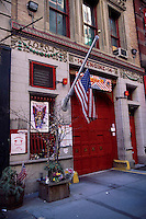 2002, Manhattan, New York City, New York State, USA --- A New York City fire station flies its flag at half-mast in remembrance of the firefighters who lost their lives on September 11, 2001. --- Image by © Owen Franken/Corbis