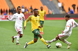 South Africa: Johannesburg: Bafana Bafana player Lebohang Kgosana Maboe battle for the ball with Seychelles player Jones Joubert during the Africa Cup Of Nations qualifiers at FNB stadium, Gauteng.<br />