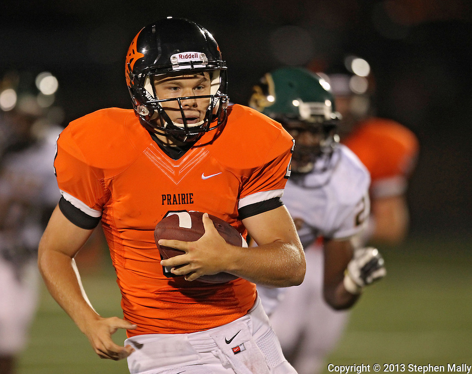 Prairie's Trey Beckman (2) scrambles with the ball during their game at John Wall Memorial Stadium at Prairie High School in Cedar Rapids on Friday, September 6, 2013.