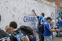 Football - 2014 / 2015 Premier League - Chelsea vs. Sunderland.   <br /> <br /> Fans sign the Champions message wall  at Stamford Bridge. <br /> <br /> COLORSPORT/DANIEL BEARHAM