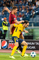 (L-R) Edin Dzeko of AS Roma, Juanfran of Club Atletico de Madrid during the UEFA Champions League group C match match between AS Roma and Atletico Madrid on September 12, 2017 at the Stadio Olimpico in Rome, Italy.