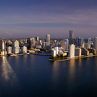 Aerial view of downtown Miami from the south overlooking Biscayne Bay at dawn showing Brickell Key.