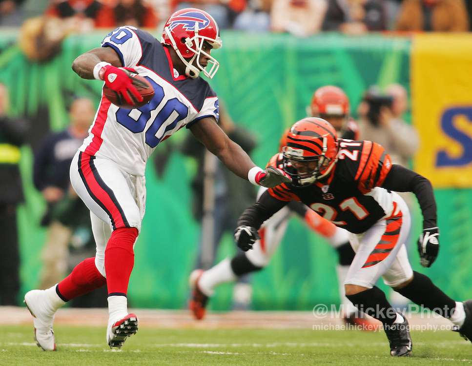 Buffalo Bills wide receiver Eric Moulds tries the allude the tackle of Rashad Bauman of the Cincinnati Bengals on Dec 24, 2005. The Bills defeated the Bengals 37-27.