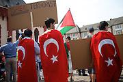 Frankfurt am Main | 26 July 2014<br /> <br /> Am Samstag (26.07.2014) demonstrierten etwa 500 Menschen auf dem R&ouml;merberg in Frankfurt am Main f&uuml;r Frieden in Pal&auml;stina / Gaza und f&uuml;r ein sofortiges Ende der israelischen Milit&auml;reins&auml;tze dort.<br /> Hier: Einige Teilnehmer der Demo f&uuml;hrten Transparente mit offen israelfeindlichen Spr&uuml;chen mit, hier z.B. &quot;IsReal Terrorist&quot;, der Tr&auml;ger und zwei andere M&auml;nner tragen die Flagge der T&uuml;rkei &uuml;ber den Schultern.<br /> <br /> &copy;peter-juelich.com<br /> <br /> FOTO HONORARPFLICHTIG!<br /> <br /> [No Model Release | No Property Release]