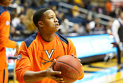 Dec 5, 2017; Morgantown, WV, USA; Virginia Cavaliers guard Devon Hall (0) warms up before their game against the West Virginia Mountaineers at WVU Coliseum. Mandatory Credit: Ben Queen-USA TODAY Sports