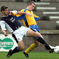 Raith Rovers v St Johnstone..30.10.04<br />Shaun Dennis battles with Chris Hay<br /><br />Picture by Graeme Hart.<br />Copyright Perthshire Picture Agency<br />Tel: 01738 623350  Mobile: 07990 594431