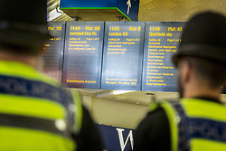 © Licensed to London News Pictures. 07/07/2015. Leeds, UK. Comuters, Police & Members of staff stood for a minutes silence in Leeds train station on the tenth anniversary of the London 7/7 bombings. Photo credit : Andrew McCaren/LNP