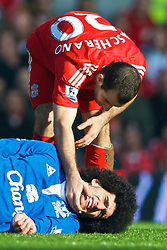 LIVERPOOL, ENGLAND - Saturday, February 6, 2010: Liverpool's Javier Mascherano and Everton's Marouane Fellaini during the Premiership match at Anfield. The 213th Merseyside Derby. (Photo by: David Rawcliffe/Propaganda)