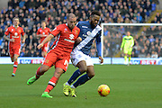 Birmingham City midfielder Jacques Maghoma and MK Dons midfielder Samir Carruthers battle during the Sky Bet Championship match between Birmingham City and Milton Keynes Dons at St Andrews, Birmingham, England on 28 December 2015. Photo by Alan Franklin.