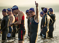 Giving the thumbs up before entering the water for the 1.2 mile swim during the Timberman 70.3.  (Karen Bobotas Photographer)