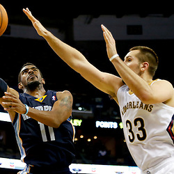 Dec 13, 2013; New Orleans, LA, USA; Memphis Grizzlies point guard Mike Conley (11) shoots over New Orleans Pelicans power forward Ryan Anderson (33) during the second half of a game at New Orleans Arena. The Pelicans defeated the Grizzlies 104-98. Mandatory Credit: Derick E. Hingle-USA TODAY Sports