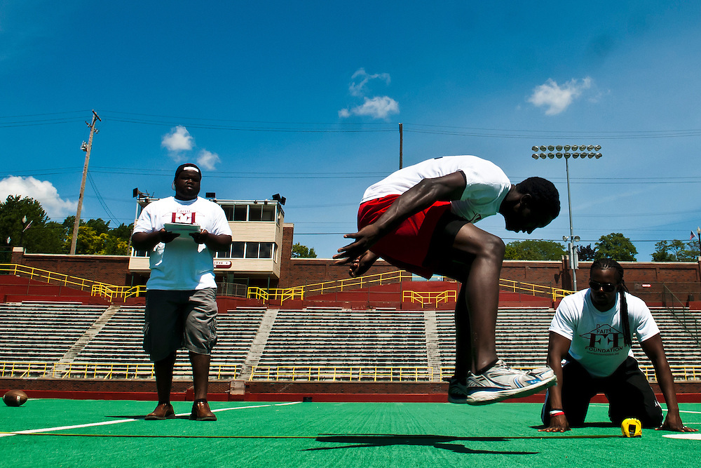 Theodore Turner, of Flint Northern, does a distance jump during a high school football combine camp put on by professional football player Chris Wilson at Atwood Stadium in Flint, Mich. on Saturday, June 23, 2012.(Lathan Goumas | MLive.com)