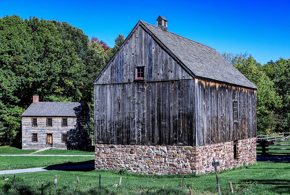 Barn and house, Genesee Country Village and Museum, Mumford, New York, USA.