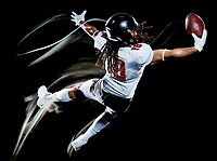 one african american football player man studio shot isolated on black background with light painting with blurred motion speed effect