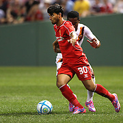 Suso, Liverpool, in action during the Liverpool Vs AS Roma friendly pre season football match at Fenway Park, Boston. USA. 23rd July 2014. Photo Tim Clayton