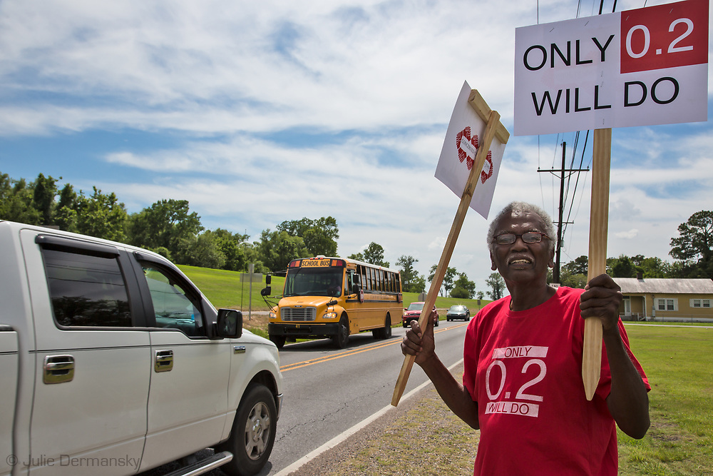 Members of the Concerned Citizens Of St John group protest near a school in Reserve LA, where they hope to bring awareness of the danger of  high levels of chloroprene emissions being emitted by Denka/Dupont in St. John the Baptist Parish. The levels emitted in the area are much higher than  the recommended EPA  standard for chloroprene, a likely human carcinogen.