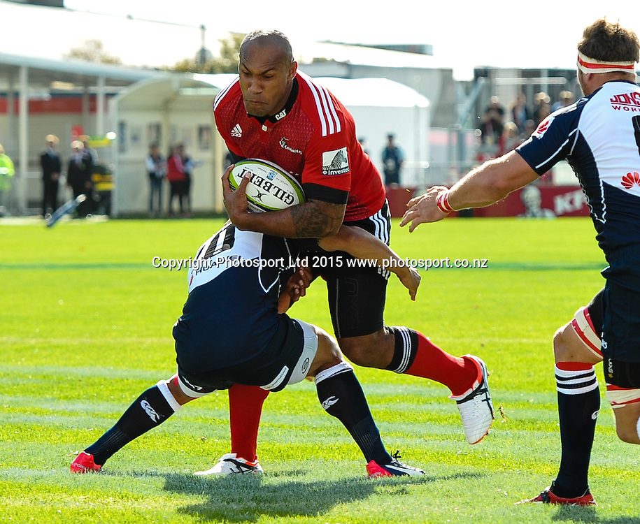 Nemani Nadolo of the Crusaders is tackled by Elton Jantjies of the Lions during the Super Rugby match: Crusaders v Lions at AMI Stadium, Christchurch, New Zealand, 14 March 2015. Copyright Photo: John Davidson / www.Photosport.co.nz