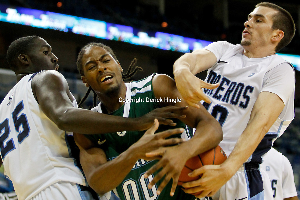 November 27, 2011; New Orleans, LA; San Diego Toreros forward/center Simi Fajemisin (25) and forward Dennis Kramer (40) battle for possession of the ball with Tulane Green Wave forward Josh Davis (00) during the first half of Hoops for Hope Classic at the New Orleans Arena.  Mandatory Credit: Derick E. Hingle-US PRESSWIRE