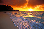 Sunset over surf, sand and peaks from Tunnels Beach, Ha'ena, Island of Kauai, Hawaii USA