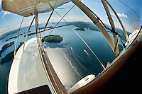A spectacular birds eye view from the open cockpit of Phil DiVirgilio's WACO WMF5C Biplane as we take flight over Lake Winnipesaukee Wednesday morning.  (Karen Bobotas/for the Laconia Daily Sun)