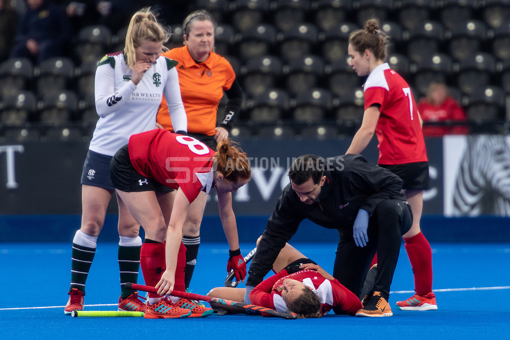 Holcombe's Eleanor Watton receives treatment after going down during making a tackle. Holcombe v Surbiton - Investec Women's Hockey League Final, Lee Valley Hockey & Tennis Centre, London, UK on 29 April 2018. Photo: Simon Parker