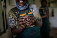 A woman at Zion Train Lodge has captured a bee-eater in her kitchen.  Shashemene, Ethiopia.