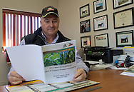 Rick Elliott in his office on his farm in Monmouth, Illinois on Friday, February 17, 2012. .